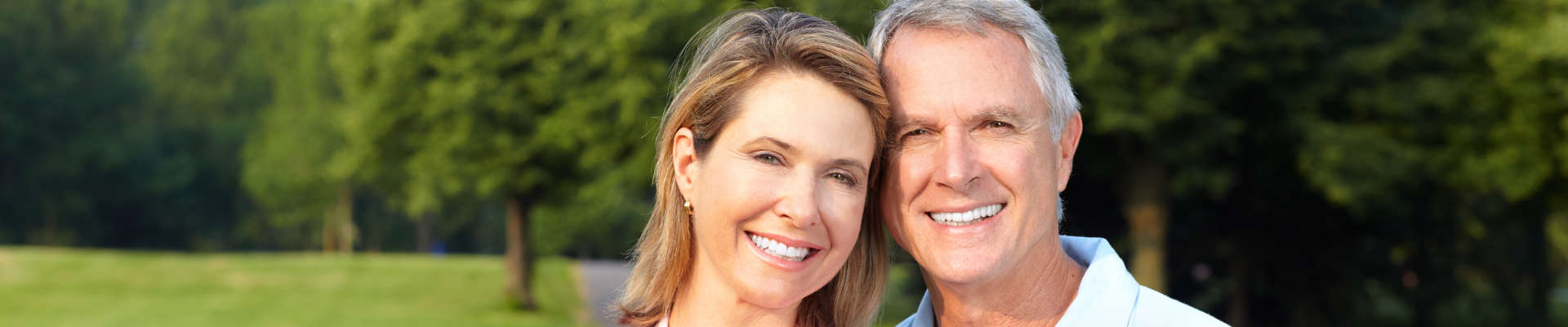 A middle age couple smiling.
