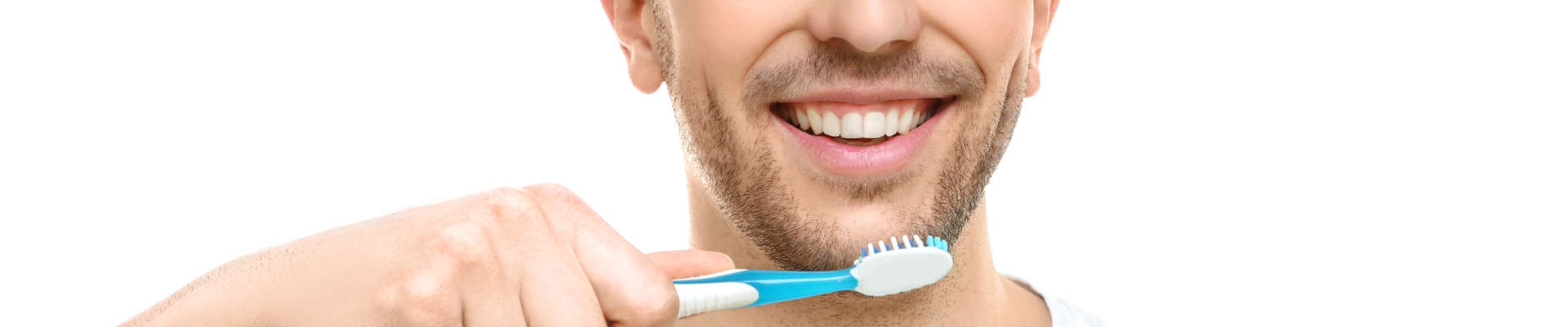 A young man is smiling. He wants to brush his teeth.